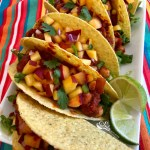 Vegan Chickpea Tacos With Peach Salsa is an easy vegan recipe that's packed with the protein of chickpeas and topped with a lime-scented fresh peach salsa! tacos | Taco Tuesday | chickpeas | tomatoes | peaches | salsa | fruit salsa | summer recipe | #swirlsofflavor
