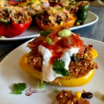 Mexican Quinoa Stuffed Peppers is an easy recipe that's perfect for a weeknight dinner and beautiful enough to serve to guests. Stuffed peppers take on a Mexican flair, bursting with a filling of quinoa, black beans, corn, tomatoes and salsa.#peppers #stuffedpeppers #quinoa #quinoastuffedpeppers #blackbeans #corn #easyrecipe #dinner #weeknightdinner #comfortfood #swirlsofflavor
