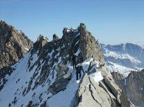 Friends climbing over Galenstock North ridge