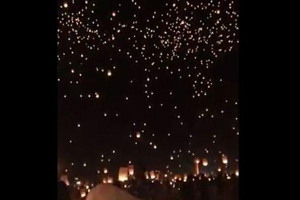 ラスベガス銃乱射事件の犠牲者を悼み、火の灯された無数のランタンが夜空に舞い上がる