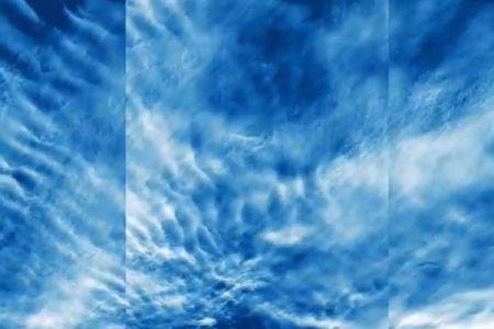 NASAが高度80キロにある極中間圏雲の撮影に成功、青く波状に広がる雲が美しい