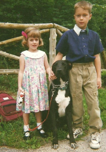 Cole and his little sister, Tara, with dog, Dave, on their first day of school at the new home.