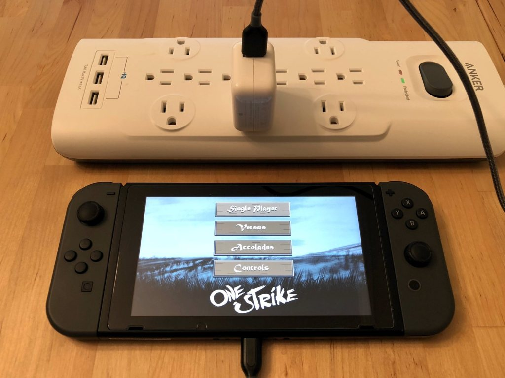 Apple 12W USB Charger with Nintendo Switch. Cable not included.