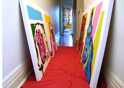 The paintings in my studio hallway, waiting to be wrapped and bed sheets and delivered to the gallery.