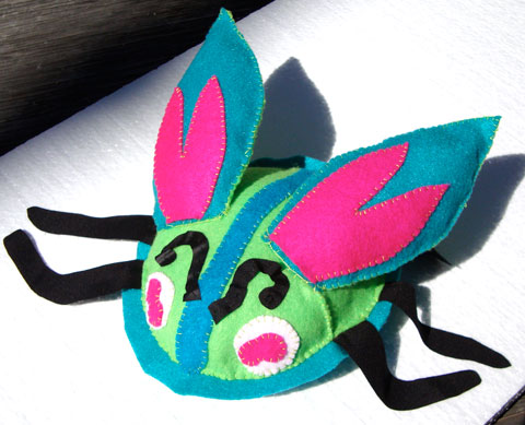 "Felt ""bug"" Christine made for Leo."