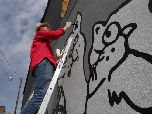 Painting Alley Cats mural May 2020
