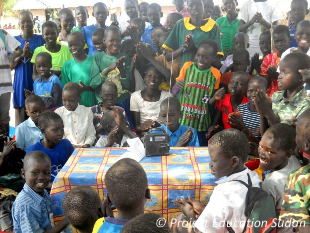 Students in South Sudan listen to their favorite shortwave radio program, VOA Learning English.