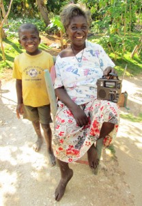 Post-earthquake, ETOW radios continue to be a vital link for those in need in Haiti. Here, Erlande, who suffered a stroke in her early 30s and can barely walk, listens to one of our self-powered Etón radios, given to her by the Haitian Health Foundation.