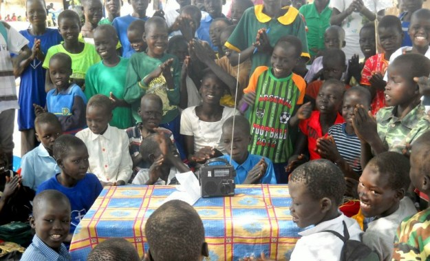 This photo was taken in South Sudan, after Ears To Our World distributed radios in this rural community for the fourth year running. This photo was taken prior to the outbreak of violence the country is currently enduring.  Can you imagine the power of information each radio can provide to its community?
