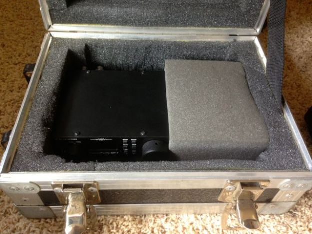A flight case I purchased for $3 at a charity store holds the CR-1, the Sony ICF-SW7600GR and the Tecsun PL-380. The case is pretty much bullet proof and protects its contents even if dropped or heavy items placed on top.