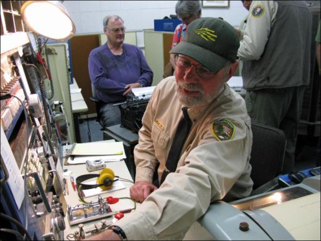 Chief Operator Richard Dillman at Position 1 (Source: Maritime Radio Historical Society)