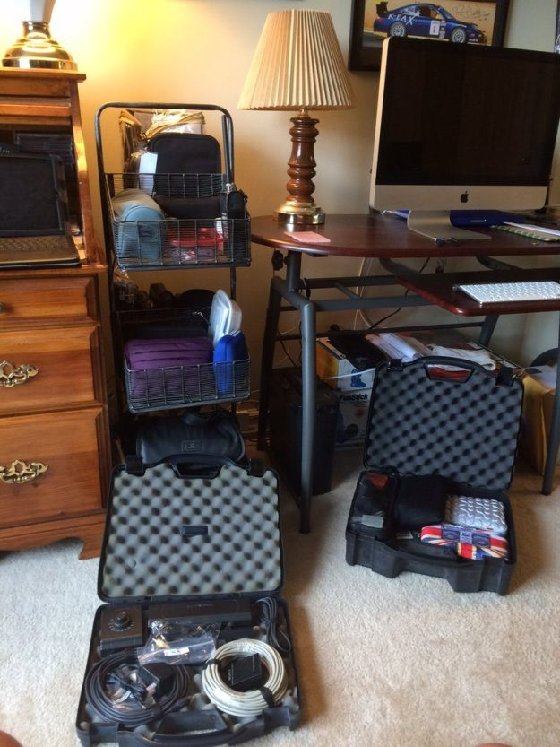 The bins and black cases with my gear (those are two Plano Gun Cases … a 2-gun case and a 4-gun case; I have 8 more filled with my astronomy gear but that's another story).