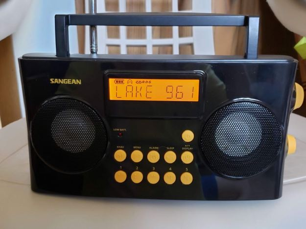 Photo of the Sangean PR-D17 AM FM Radio while tuned to 96.1 FM and showing RDS backlit display