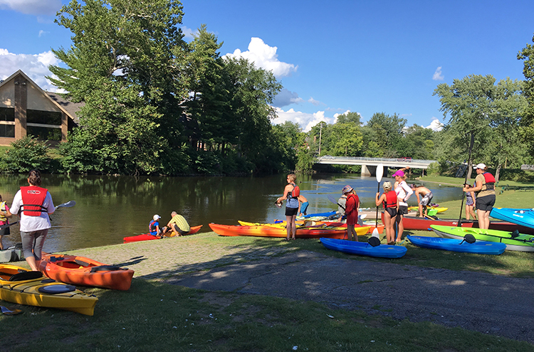 Approximately 25 paddlers embarked from the Merrill Park boat launch during last Monday's Kanoe the Kazoo/Drink One Down benefit event.