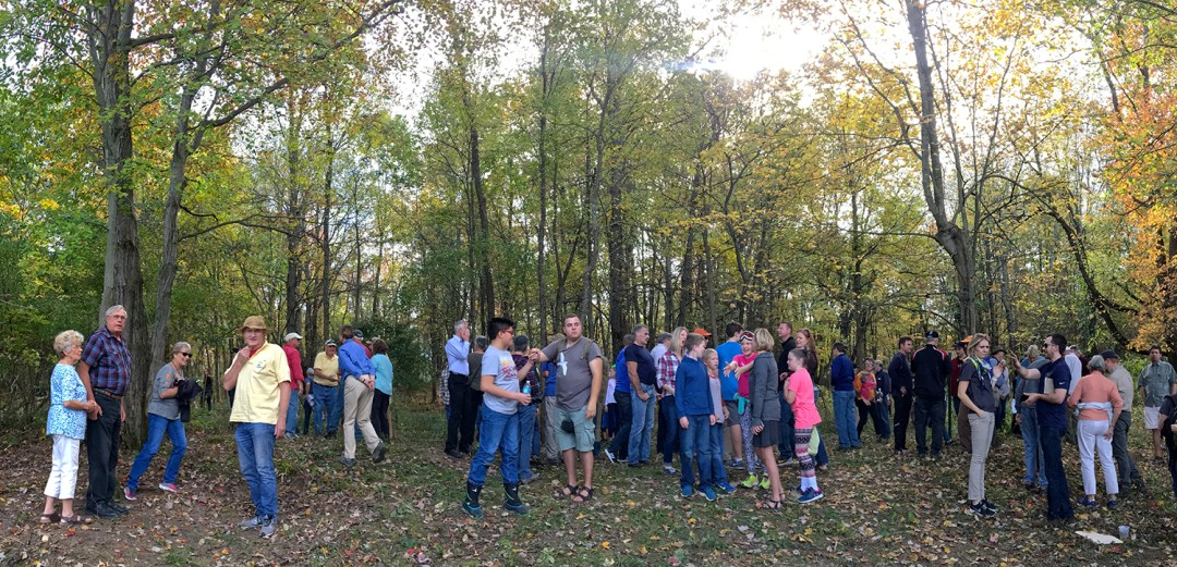 A panoramic shot of people leaving the ribbon-cutting ceremony, many of whom were anxious to take a guided hike of the new preserve.