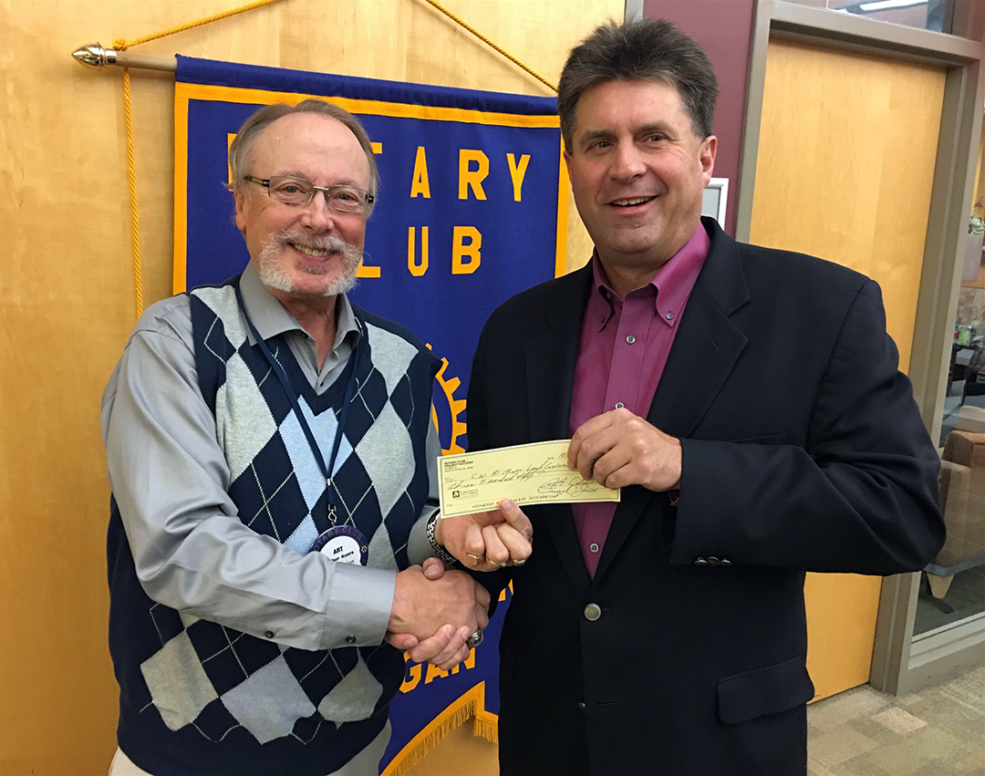 South Haven Rotary Grants Chair, Art Ayers, presenting a $350 grant to SWMLC's Executive Director Peter TerLouw.