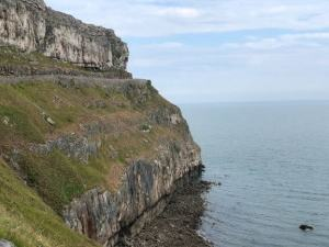 The winding road of the Great Orme Coastal Path in llandudno, with a cliff dropping to the sea.