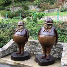 Statue of Tweedledee & Tweedledum from Alice in Wonderland in Llandudno