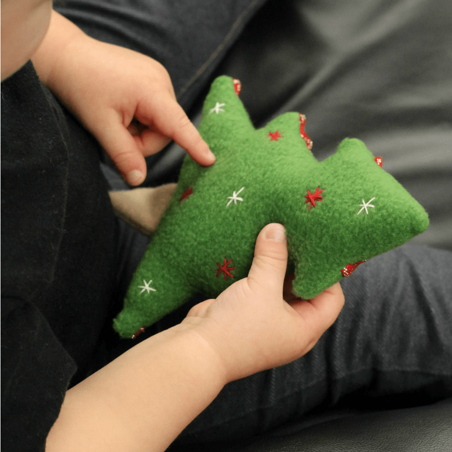 Christmas Tree Softie - a free pattern from Swoodson Says. Sew up a soft holiday tree to snuggle, turn it into a finger puppet, or add a ribbon and make it an ornament!