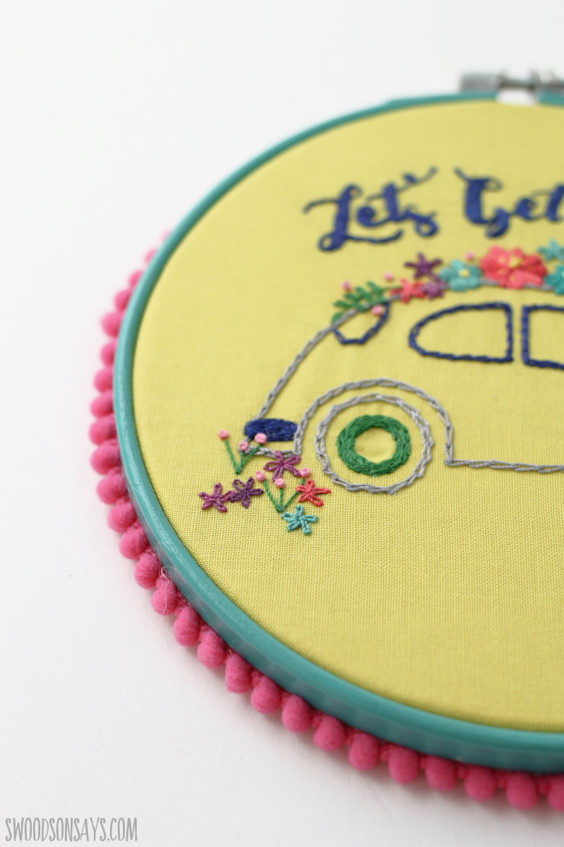 add pom poms to embroidery hoop