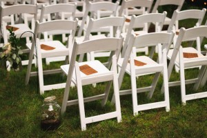 illustrates white chairs at a wedding reception