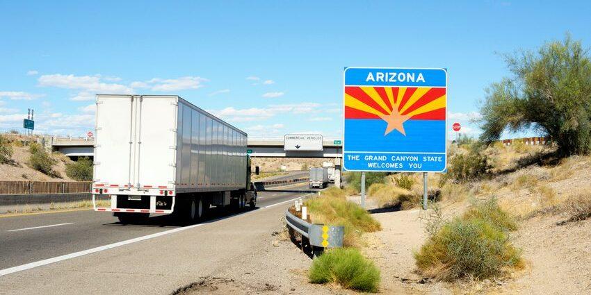 Transport trucks crossing the border into Arizona.