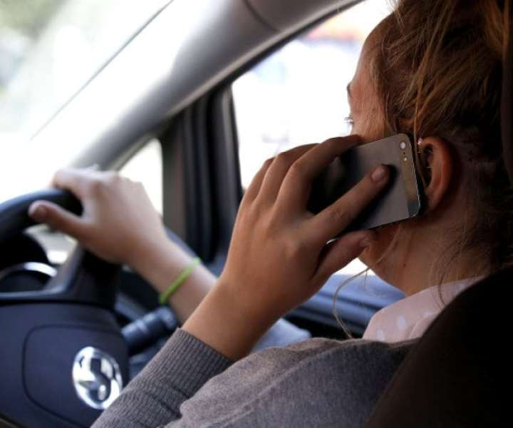 POSED BY MODELFile photo dated 13/08/14 of a woman using a mobile phone at the car wheel, as police data has shown that the number of motorists caught using a mobile phone illegally has almost halved since penalties for offenders were doubled. PRESS ASSOCIATION Photo. Issue date: Thursday March 1, 2018. The new figures suggest that around 39,000 fixed penalty notices (FPNs) were issued to drivers between March and December last year compared with 74,000 during the same period in 2016. See PA story TRANSPORT Mobiles. Photo credit should read: Jonathan Brady/PA Wire
