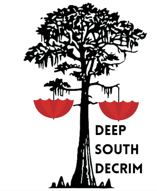 A tree with red umbrellas and the text deep south decrim