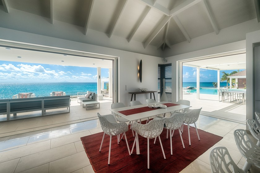 indoor kitchen table with ocean views at villa turtle nest on baie longue beach