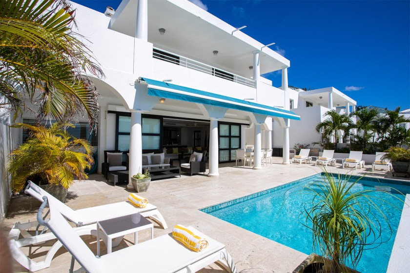 White villa with blue pool