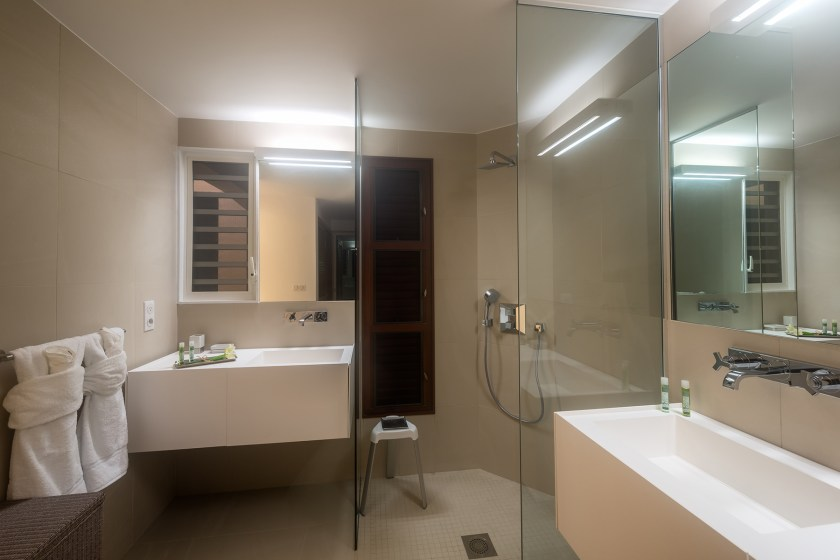 bathroom with sink and shower at villa turtle nest in baie longue st martin