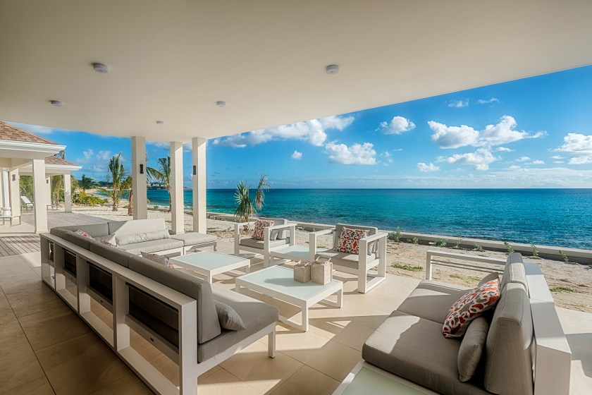 outdoor couch and seating area with ocean views at villa turtle nest in st martin