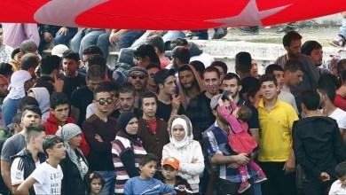 صورة دًا للجميل.. طالبو لجوء ينتجون كمامات للتضامن مع تركيا