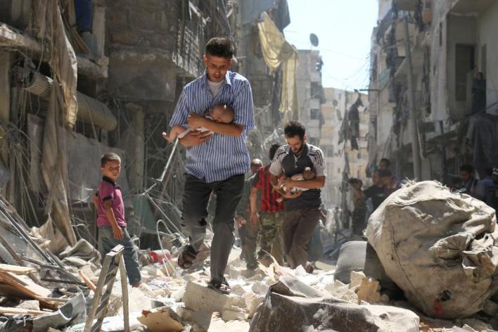 الصورة التي التقطها أمير في أثناء تغطية المعارك في حلب وحصل بسببها على جائزة