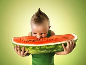 punk boy eating a big slice of watermelon