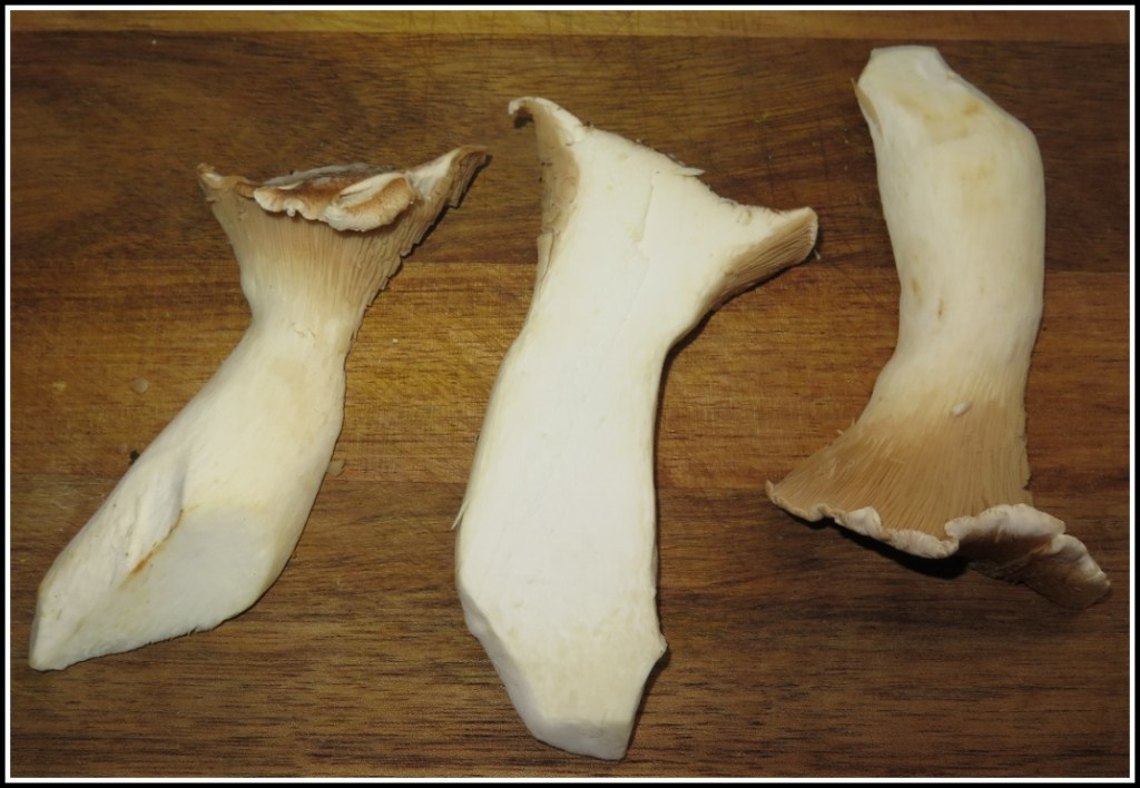 A King Oyster Mushroom sliced to show the interior.
