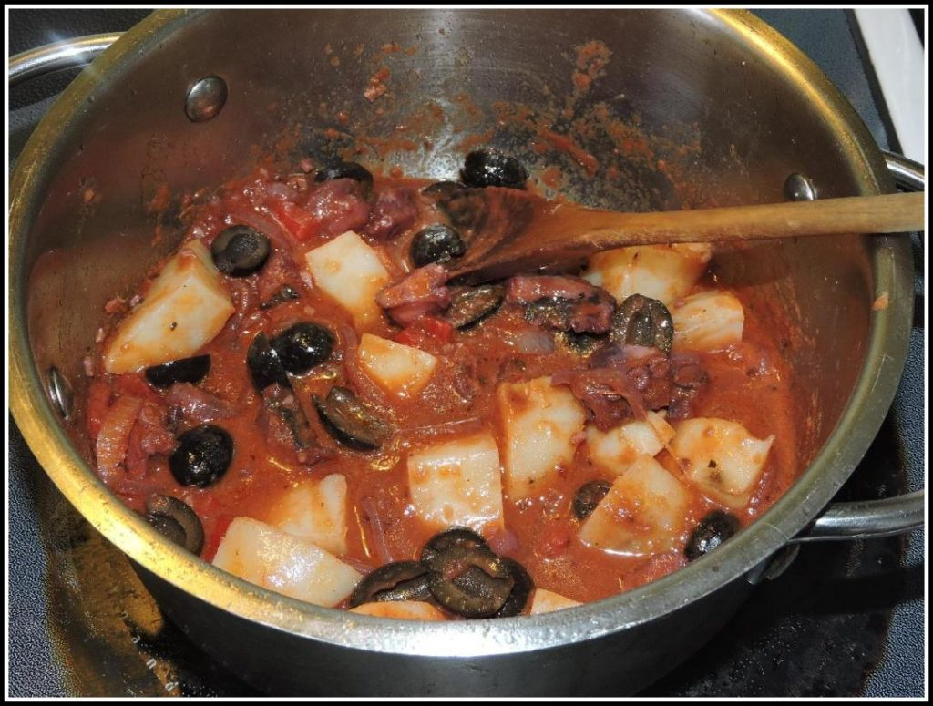 Finishing the Octopus Stew with potatoes and black olives