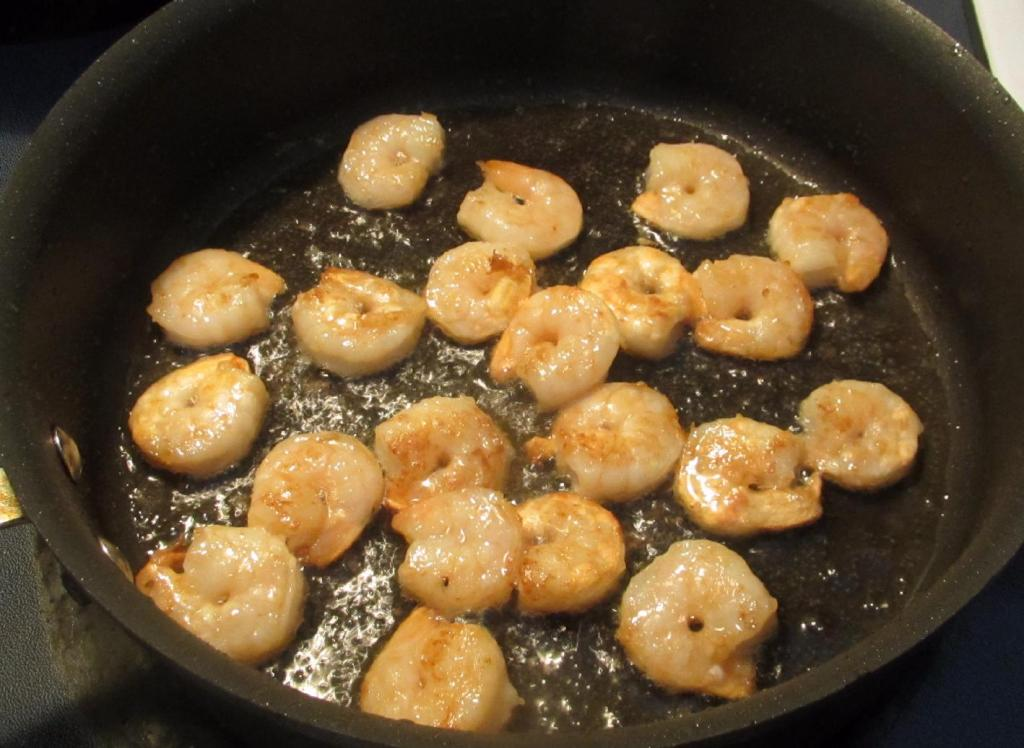Pan-frying the shrimp.