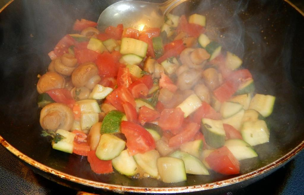 Finishing the Zucchini with Mushrooms and Tomatoes