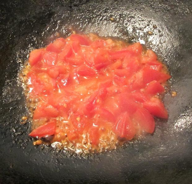 Stir-frying the Tomatoes