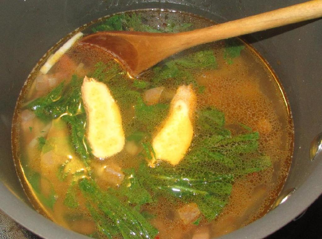 Simmering the Preserved Pork Belly and Daikon Soup