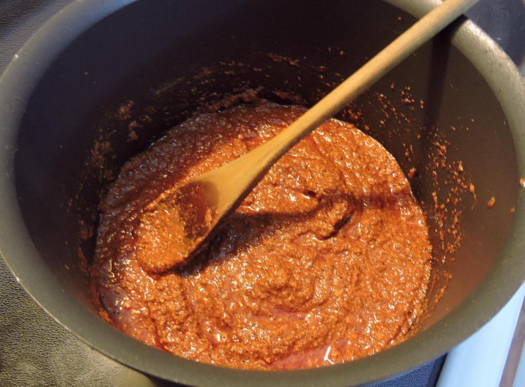 Madras Curry Powder Blended with Chili, Garlic and Ginger Pastes and Vinegar.