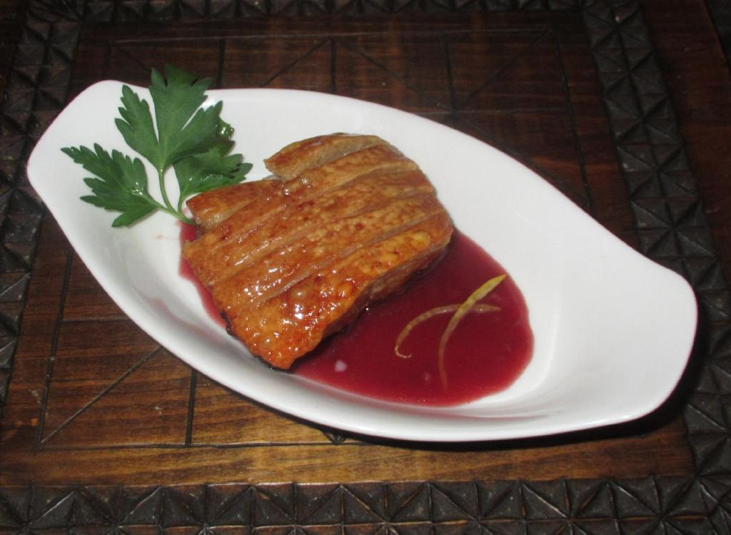 An appetizer of Crispy Pork Belly with Cumberland Sauce.
