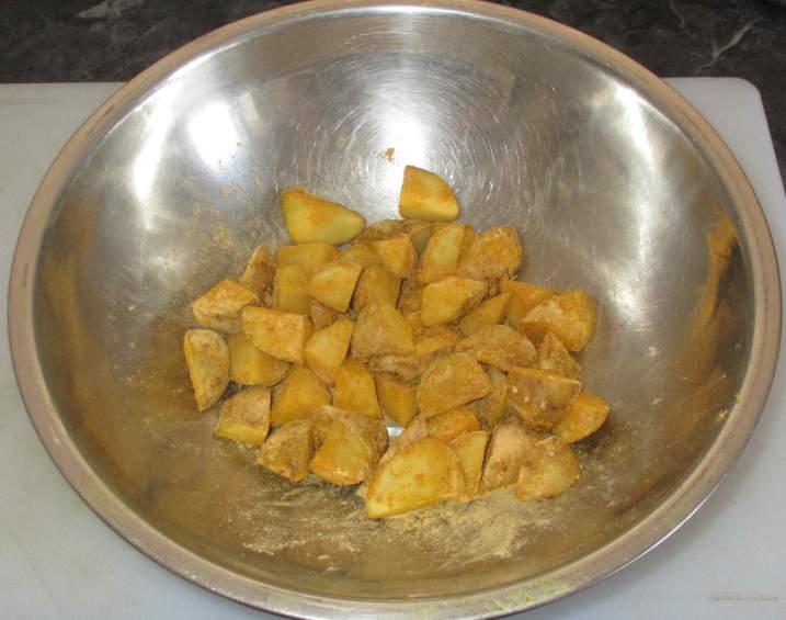 Coating Potatoes with seasoned Besan