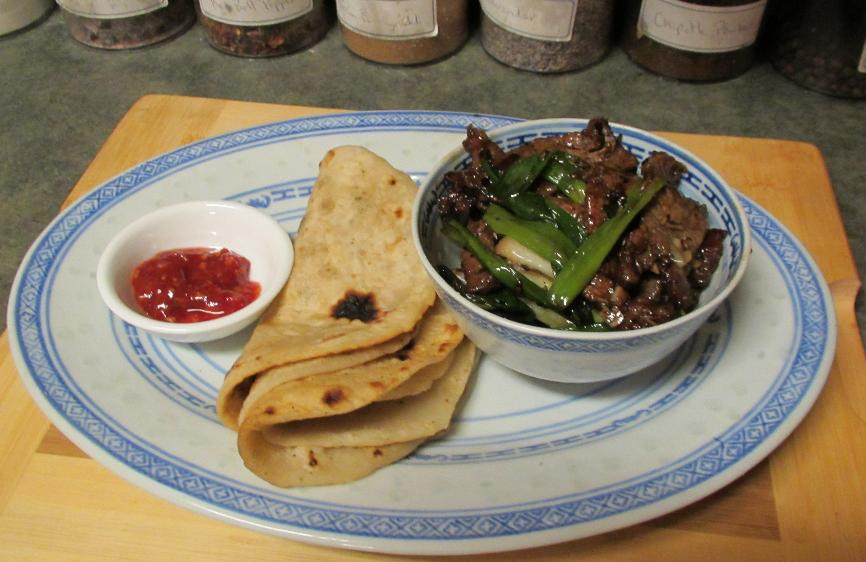 Beef with Cumin and Scallion served with Flatbread and Chili Sauce