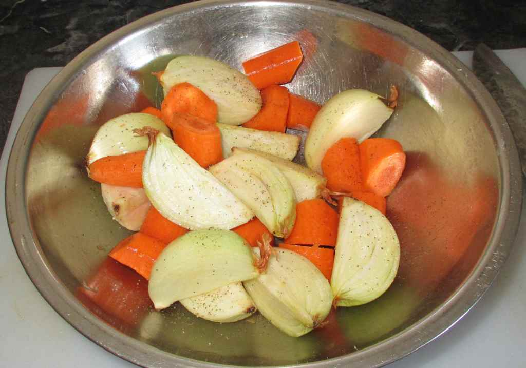 Tossing Onion and Carrot with seasonings and Oil