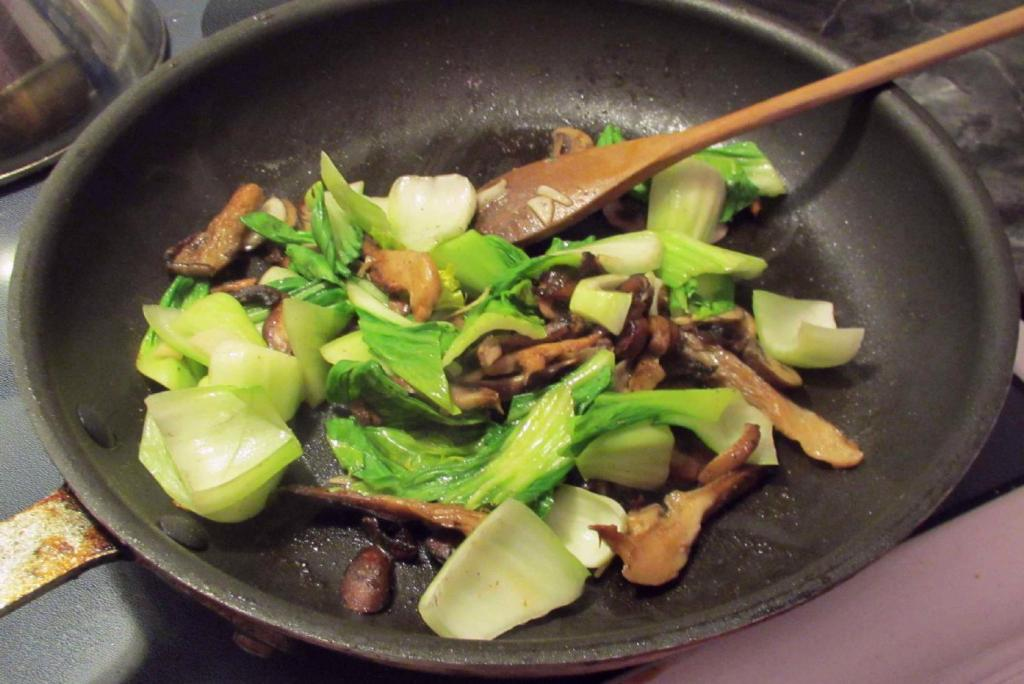Finishing Italian-style Bok Choy with Mushrooms