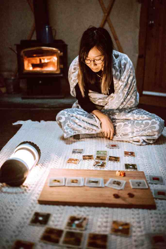 Playing board games using the light from extra battery-powered lanterns