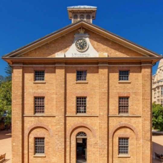 Colonial era brick building with clock tower.