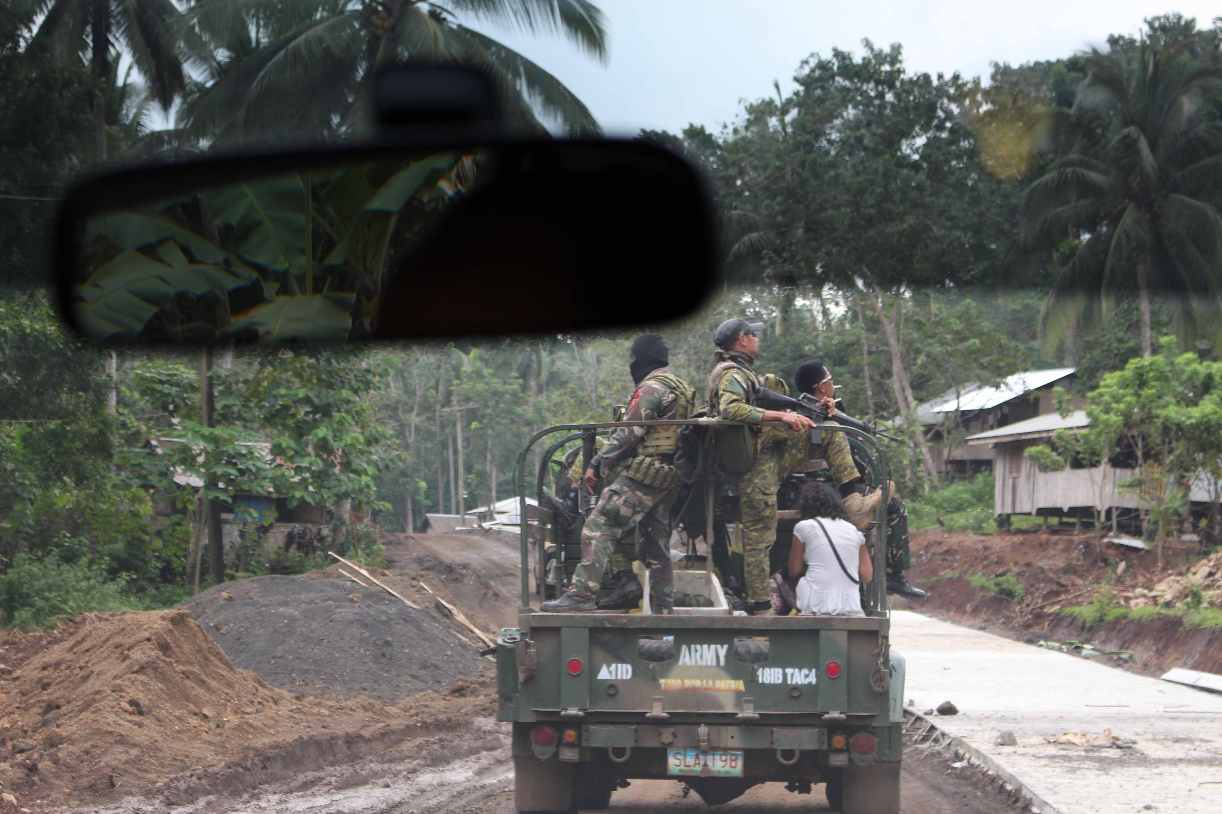 Ambush route: soldiers scan for IEDs and gunmen on the drive through Tipo Tipo